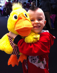 boy with fluffy disco duck toy